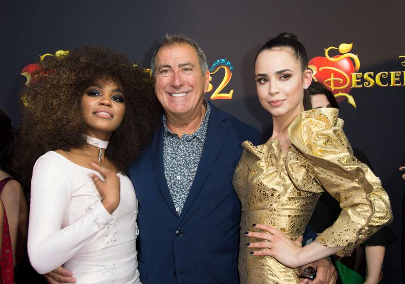 """(L-R) Actress China Anne McClain, Director Kenny Ortega and Singer Sofia Carson attend the Red Carpet Premiere Event for """"The Descendants 2"""" at the Arclight Cinerama Dome, on July 11, 2017, in Hollywood, California. / AFP PHOTO / VALERIE MACON"""