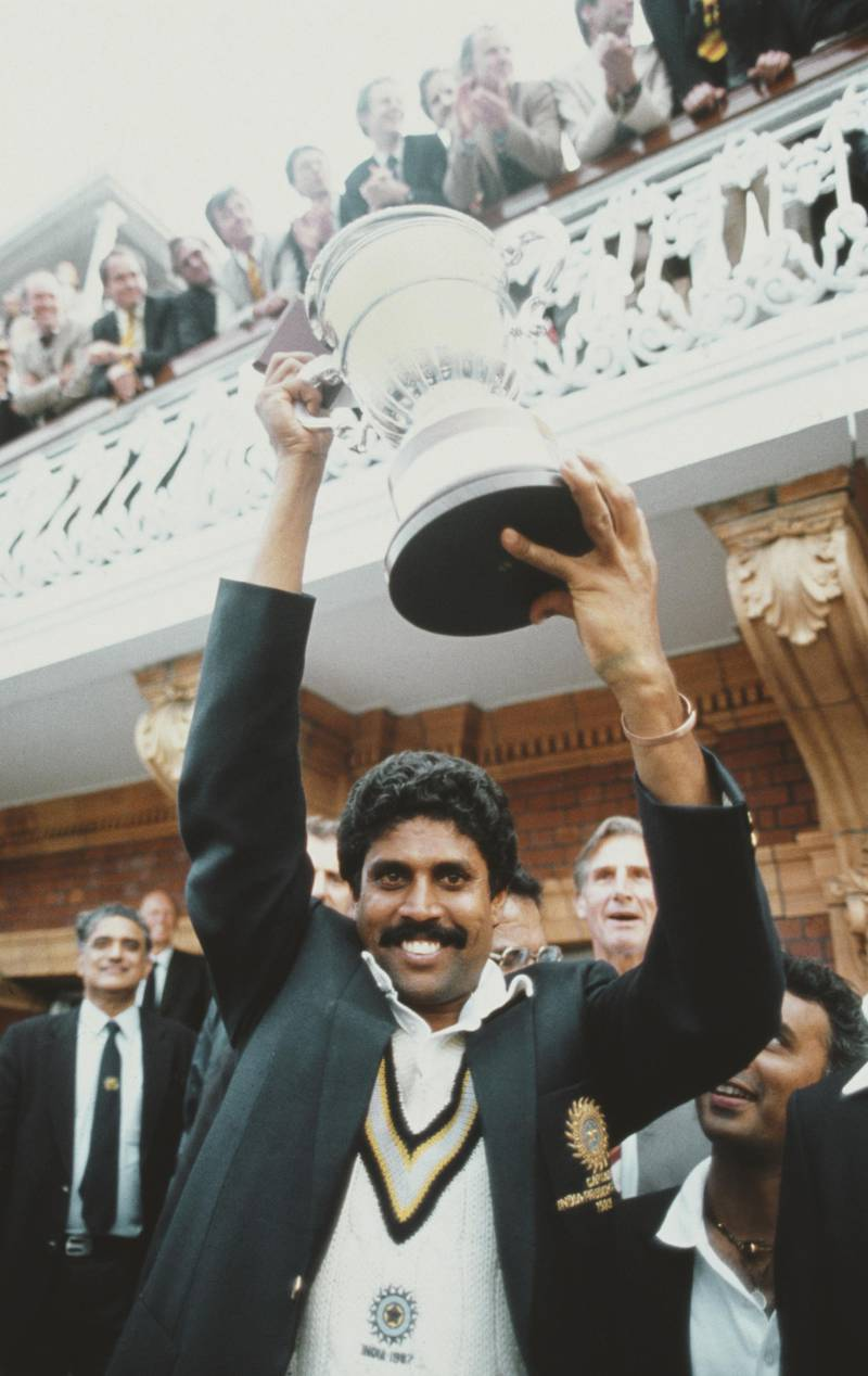 LONDON, UNITED KINGDOM - JUNE 23:  India captain Kapil Dev lifts the trophy on the balcony of the pavillion as Sunil Gavaskar (obscured right) looks on after the 1983 Prudential World Cup Final victory against West Indies at Lords on June 23, 1983 in London, England.  (Photo by Adrian Murrell/Allsport/Getty Images)