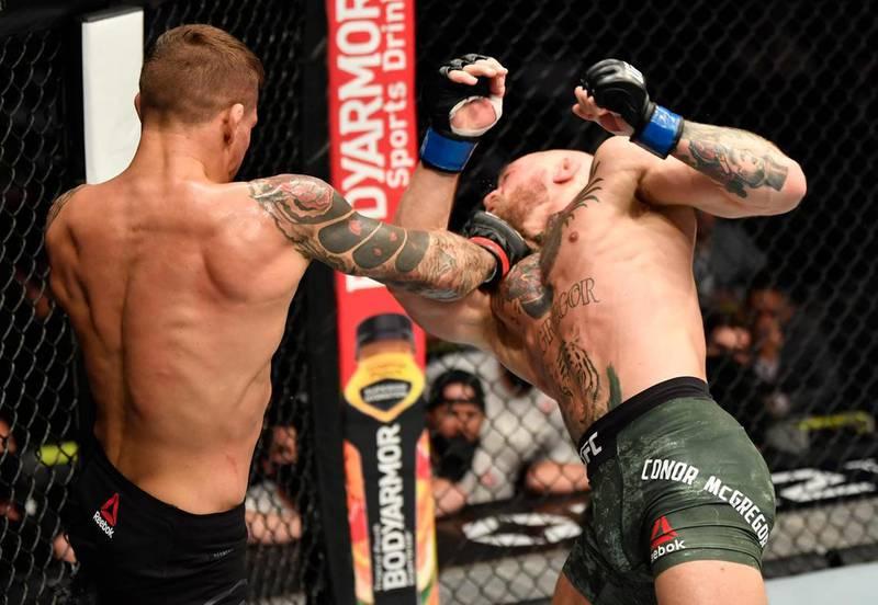 Dustin Poirier punches Conor McGregor. Jeff Bottari/Zuffa LLC