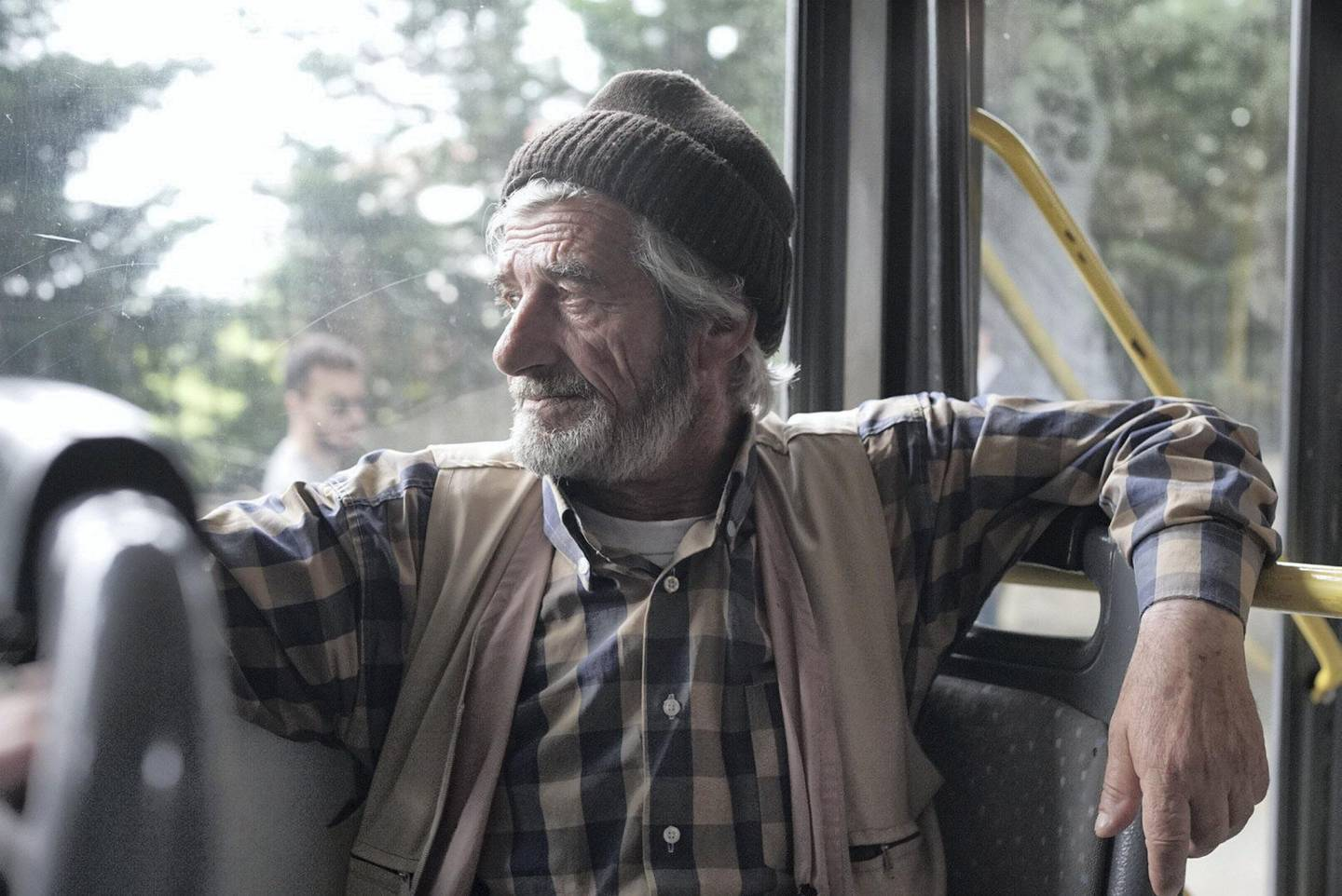 Writing the bus and having just came from voting, Zeki Nuria, 69, fisherman, he says that he voted for AKP because Turkey is going in the right direction. Photo by Shawn Carrié