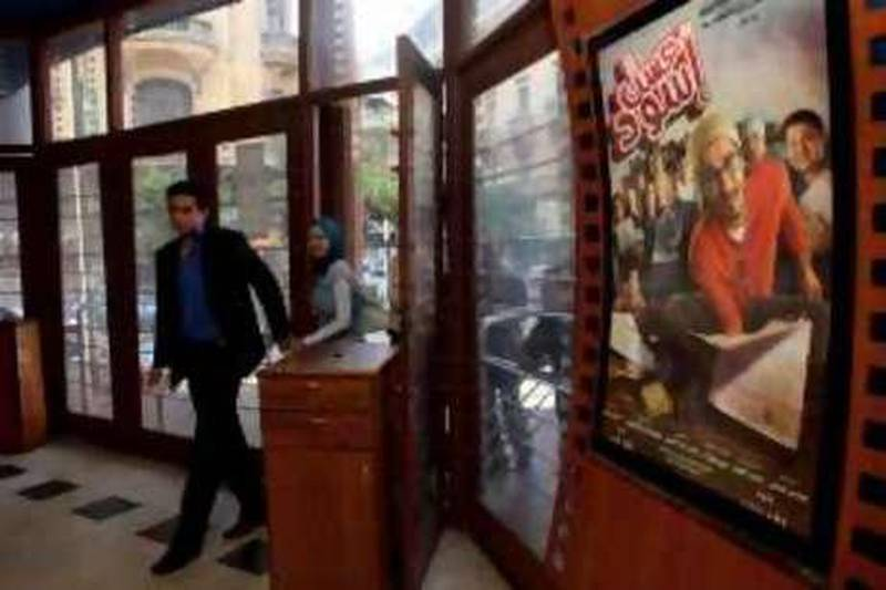 """Egyptian movie fans enter a theater June 15, 2010 to see the recently released film by Egyptian comedy star Ahmed Helmy entitled """"Asal Eswed"""" (literally translated, """"Black Honey"""") in downtown Cairo, Egypt. The film is a social satire that tackles  issues of national identity. (Photo by Scott Nelson for the National)"""