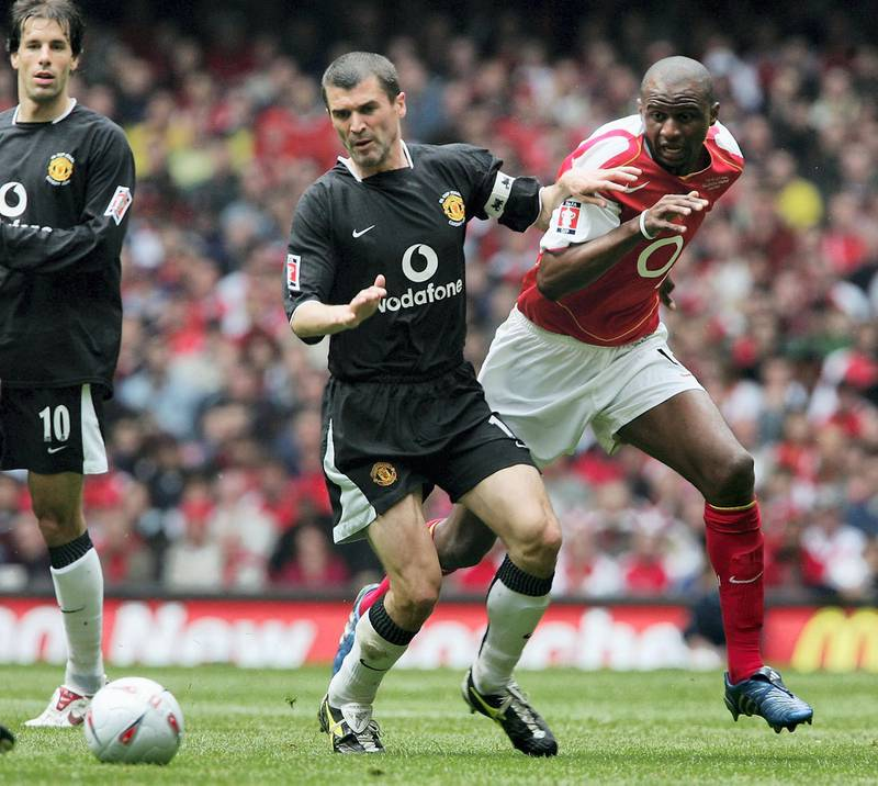 CARDIFF, WALES - MAY 21:  Patrick Vieira of Arsenal and Roy Keane of Manchester United battle for the ball during the FA Cup Final between Arsenal and Manchester United at The Millennium Stadium on May 21, 2005 in Cardiff, Wales.  (Photo by Phil Cole/Getty Images)