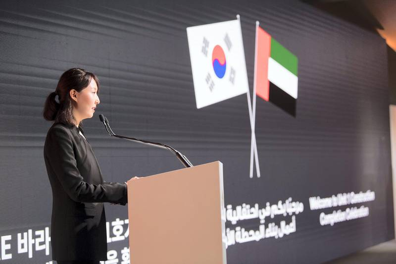 AL DHAFRA, ABU DHABI, UNITED ARAB EMIRATES - March 26, 2018: Jieun Jeung, an Emirates Nuclear Energy Corporation employee, delivers a speech during the Unit One Construction Completion Celebration, at Barakah Nuclear Energy Plant.   ( Abdullah Al Junaibi ) ---