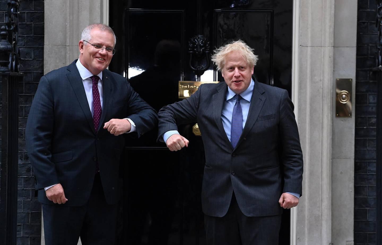 epa09271506 British Prime Minister Boris Johnson (R) welcomes Australian Prime Minister Scott Morrison (L) at 10 Downing Street in London, Britain, 14 June 2021.  EPA/ANDY RAIN