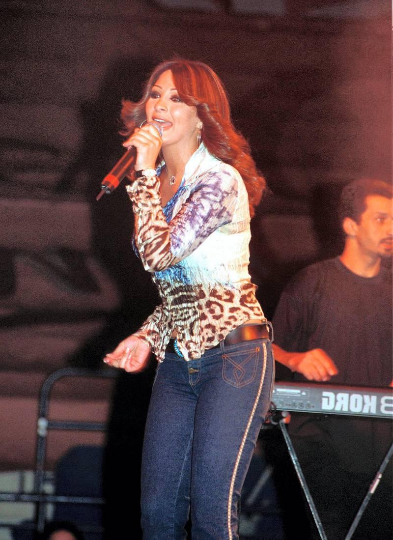 Lebanese singer Elissa performs in Dubai 12 November 2001. Elissa arrived in Dubai to present a show with Lebanese singers Yuri Murrakadi, Aline Khalaf, Maysam Nahas and Algerian singer Cheb Mami. (Photo by EDDY PADO / AFP)
