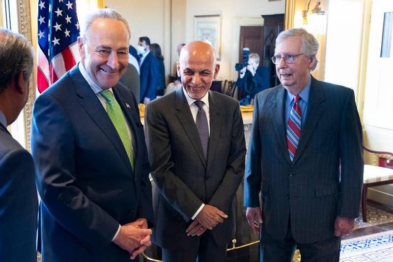 epa09299240 President of Afghanistan Ashraf Ghani (C) is hosted by Senate Majority Leader Chuck Schumer (L) and Senate Minority Leader Mitch McConnell (R) on Capitol Hill, in Washington, DC, USA, 24 June 2021.  EPA/MICHAEL REYNOLDS