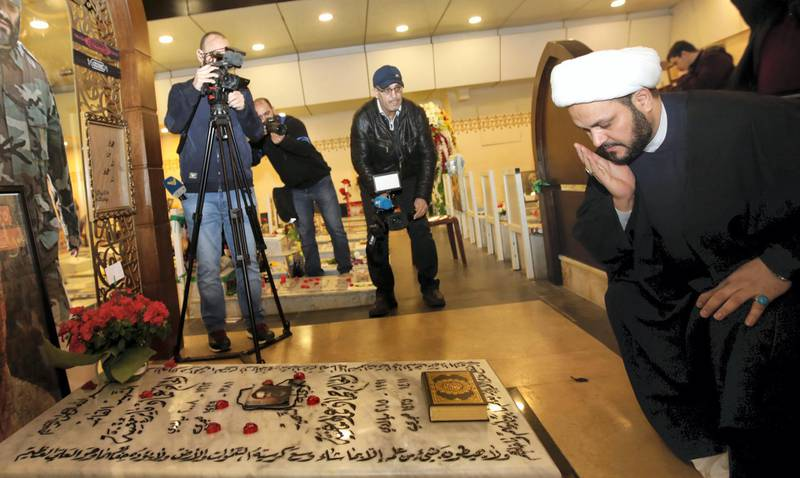 """Secretary General of Shitte Iraqi Al-Nujabaa movement Akram al-Kaabi prays over the tomb of Hezbollah slain military leader Imad Moghnieh in Beirut's southern suburb on February 13, 2018. (Photo by ANWAR AMRO / AFP) / """"The erroneous mention[s] appearing in the metadata of this photo by ANWAR AMRO has been modified in AFP systems in the following manner: [Akram] instead of [Abbas]. Please immediately remove the erroneous mention[s] from all your online services and delete it (them) from your servers. If you have been authorized by AFP to distribute it (them) to third parties, please ensure that the same actions are carried out by them. Failure to promptly comply with these instructions will entail liability on your part for any continued or post notification usage. Therefore we thank you very much for all your attention and prompt action. We are sorry for the inconvenience this notification may cause and remain at your disposal for any further information you may require."""""""