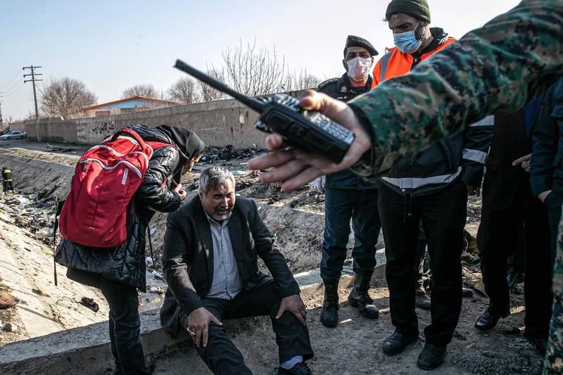 08 January 2020, Iran, Shahedshahr: A man cries at the scene, where a Ukrainian airplane carrying 176 people crashed on Wednesday shortly after takeoff from Tehran airport, killing all onboard. Photo: Foad Ashtari/dpa (Photo by Foad Ashtari/picture alliance via Getty Images)