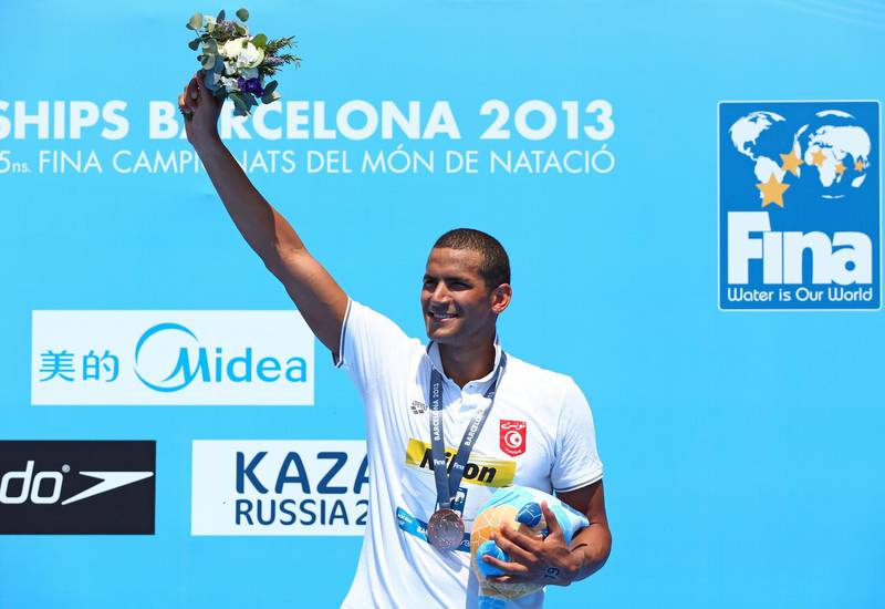 BARCELONA, SPAIN - JULY 22:  Bronze medallist Oussama Mellouli of Tunisia celebrates third place after the Open Water Swimming Men's 10k race on day three of the 15th FINA World Championships at Moll de la Fusta on July 22, 2013 in Barcelona, Spain.  (Photo by Quinn Rooney/Getty Images)