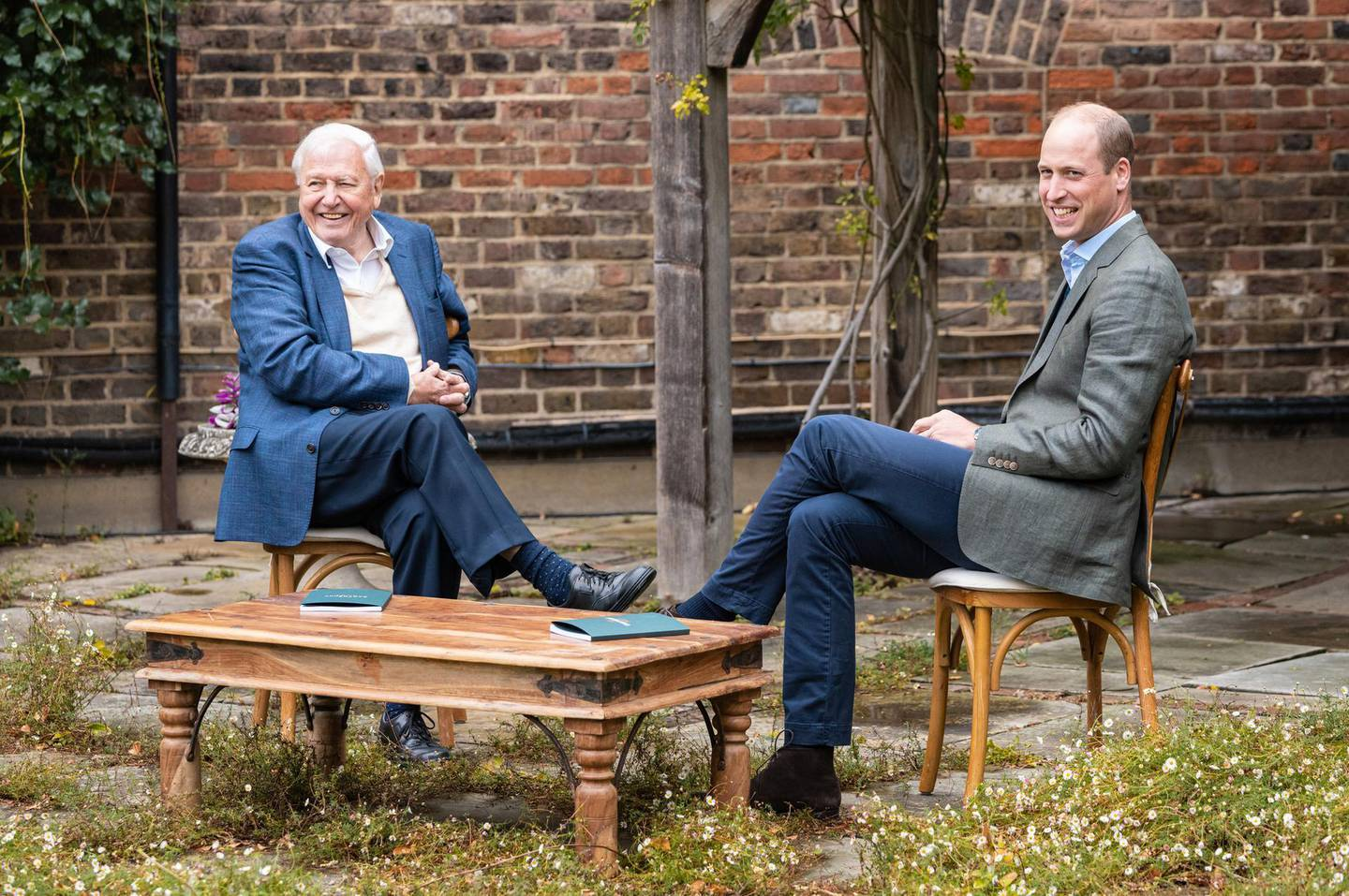 LONDON, ENGLAND: (EMBARGOED TO 0001 ON OCTOBER 8, 2020) (NO SALES) In this undated photo issued by Kensington Palace, Prince William, Duke of Cambridge and Sir David Attenborough discuss The Earthshot Prize at Kensington Palace, in London, England. (Photo by Kensington Palace via Getty Images) NOTE TO EDITORS: This handout photo may only be used in for editorial reporting purposes for the contemporaneous illustration of events, things or the people in the image or facts mentioned in the caption. Reuse of the picture may require further permission from the copyright holder.