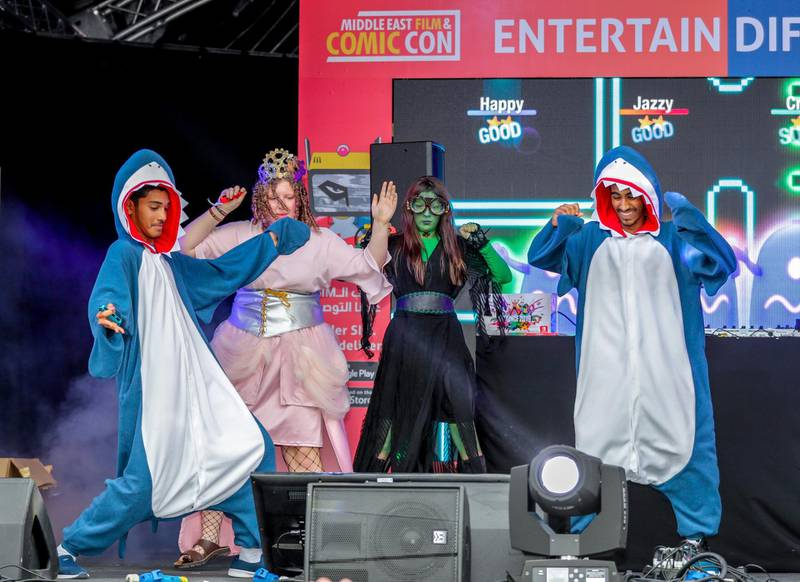 Dubai, April 12, 2019.  MEFCC day 2-Comic Con goers at full swing on day 2.  The baby sharks win the Nintendo home system. Victor Besa/The National.Section:  AC  Reporter:  Chris Newbould