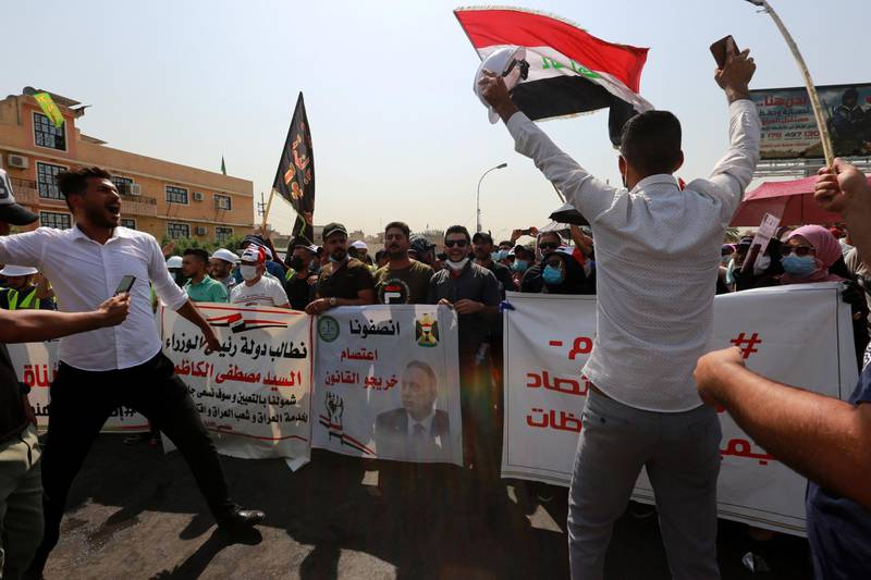 epa08656674 Jobless graduates chant slogans during a demonstration near the heavily fortified Green Zone which houses the Iraqi government offices in central Baghdad, Iraq, 09 September 2020. Thousands of university graduates and jobless people continue their protests in Baghdad outside government ministries demanding jobs, while the Iraqi government admits it has not planned for the large numbers of students coming into the job market every year.  EPA-EFE/AHMED JALIL *** Local Caption *** 56329546