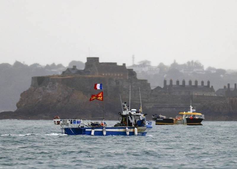 """(FILES) In this file photo taken on May 6, 2021 French fishing boats protest in front of the port of Saint Helier off the British island of Jersey to draw attention to what they see as unfair restrictions on their ability to fish in UK waters after Brexit. The government of Jersey, a Channel Island between France and Britain, said on June 28, 2021 that it has decided to extend a transitional fishing agreement with the European Union that would allow EU boats to continue operating in its waters for three months. """"The EU has recently requested an extension to the transitional arrangements, which had been due to come to an end on 30 June,"""" a statement from the Jersey government said, adding that """"Jersey Ministers have agreed to that request."""" - ALTERNATIVE CROP  / AFP / Sameer Al-DOUMY / ALTERNATIVE CROP"""