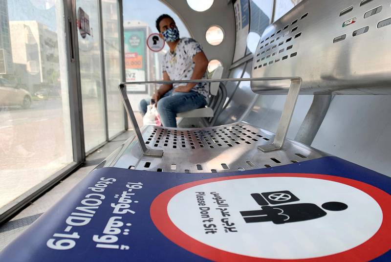 DUBAI, UNITED ARAB EMIRATES , October 3 – 2020 :- Social distancing stickers pasted at the Bus stop as a preventive measure against the spread of coronavirus in Al Karama area in Dubai. (Pawan Singh / The National) For News/Stock/Online.