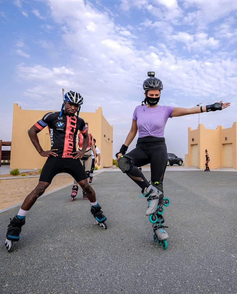 Abu Dhabi, United Arab Emirates, August 21, 2020.   The Madrollers skating group at the Al Wathba Bicycle Track do a  8 km. fun sprint.  The skating group has members from Dubai and Abu Dhabi.  They encourage safety and discipline on roller-skates, skateboard, long-board and bicycles.  --Rollerbladers do limbering exercises before going on the 8 km fun sprint.Victor Besa /The NationalSection:  Photo ProjectReporter: