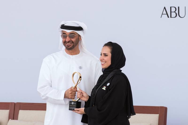 ABU DHABI, UNITED ARAB EMIRATES - March 12, 2018: HH Sheikh Mohamed bin Zayed Al Nahyan, Crown Prince of Abu Dhabi and Deputy Supreme Commander of the UAE Armed Forces (L), presents an Abu Dhabi Award to Farah Hashem Al Qaissieh (R), during the awards ceremony at the Sea Palace. ( Saeed Al Muhairi / Crown Prince Court - Abu Dhabi ) ---