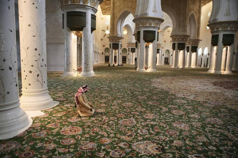 United Arab Emirates - Abu Dhabi - September 2 - 2008:  Mohammed Al Harmoudi prays at Sheikh Zayed Grand Mosque Tuesday afternoon (Galen Clarke/The National) *** Local Caption ***  GC-Ramadan-05.jpgGC-Ramadan-05.jpg