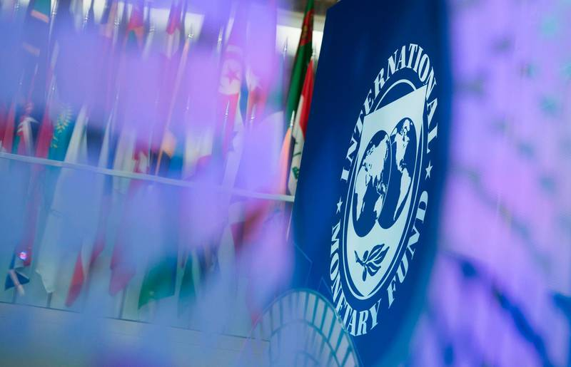 """(FILES) In this file photo taken on October 10, 2017 a logo for the 2017 Annual Meetings is seen inside the International Monetary Fund (IMF) headquarters in Washington, DC. The spring gathering of finance ministers and central bankers held in Washington in April will be shifted to a """"virtual format"""" due to the coronavirus epidemic, the IMF and World Bank said March 3, 2020. The twice-yearly meetings of the development lending institutions attract thousands of officials and private sector participants from 180 member countries -- just the kind of gathering health authorities say should be avoided.  / AFP / Andrew CABALLERO-REYNOLDS"""