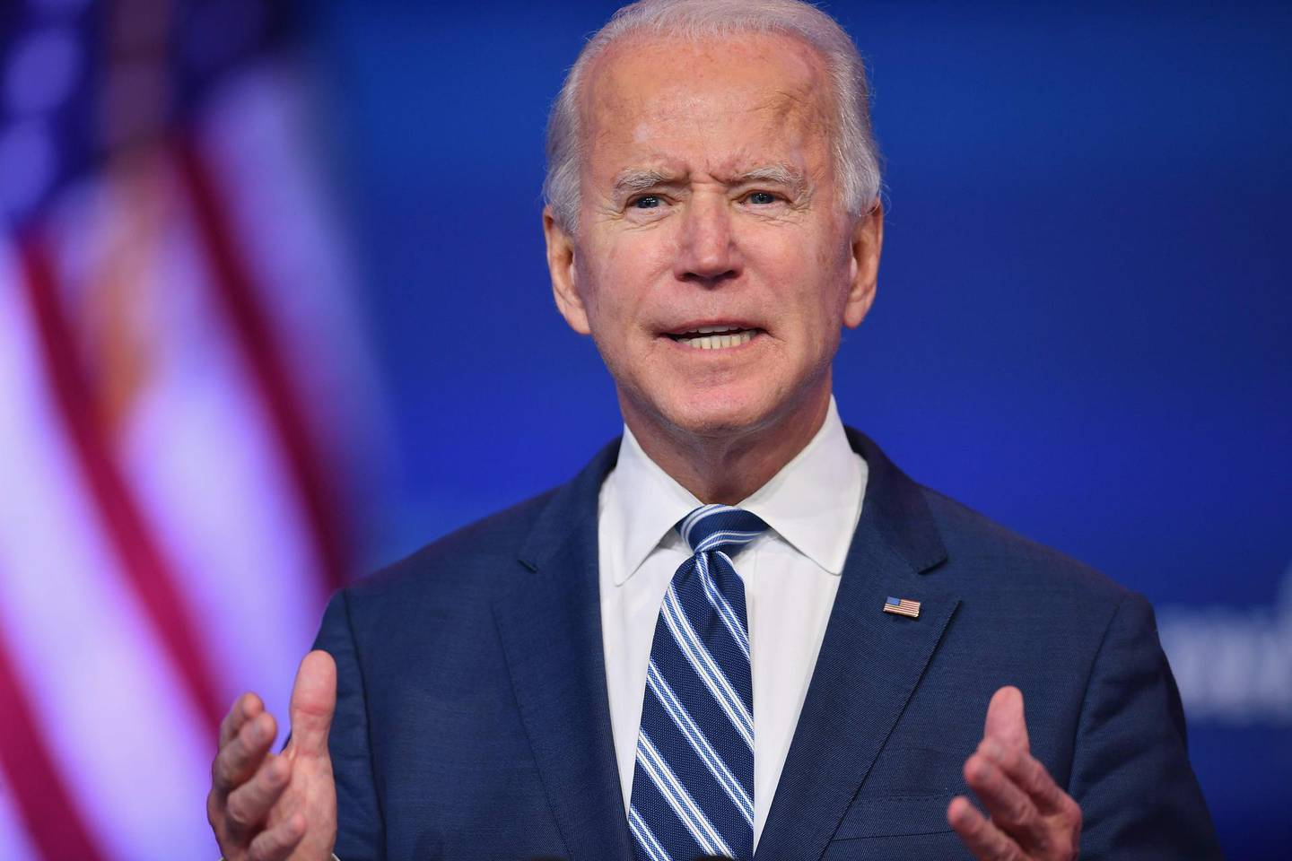 """(FILES) In this file photo taken on November 10, 2020 US President-elect Joe Biden delivers remarks at The Queen in Wilmington, Delaware. After Donald Trump in his first week as president spoke to Australia's prime minister, leaks of  the call left many dumbfounded, with the new US leader haranguing and hanging up on the close ally. When Joe Biden spoke by phone Thursday with Prime Minister Scott Morrison, the president-elect's office said Biden hoped to work with him on """"many common challenges"""" and the Australian leader said he would forward a study on how his country fought Covid-19 through contact tracing. Following four years of presidential pique and chronic chaos in dealing with foreign leaders, Biden has already signaled a reversal -- he is making US diplomacy predictable, even dull, again. / AFP / Angela Weiss"""