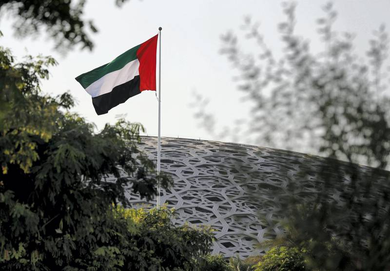 Abu Dhabi, United Arab Emirates, September 17, 2020.  The U.A.E. flag proudly waves at the Louvre Abu Dhabi on a Thursday afternoon.  Victor Besa/The National.Section: Standalone
