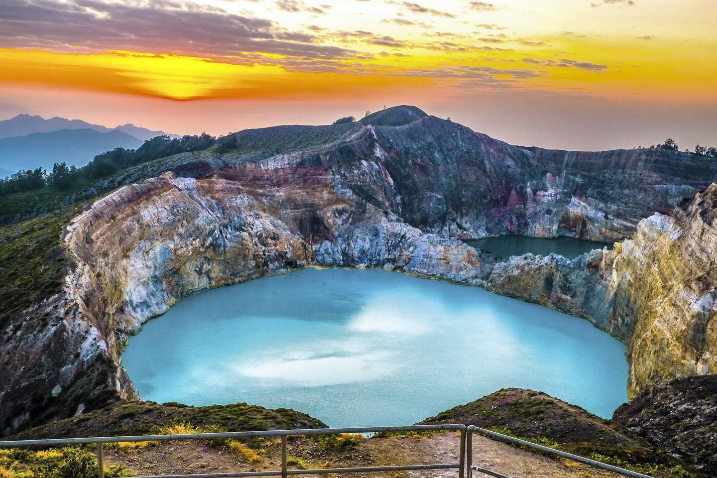 A volcano located on Flores island in Indonesia that has with  three crater lakes that changes colours throughout the year.