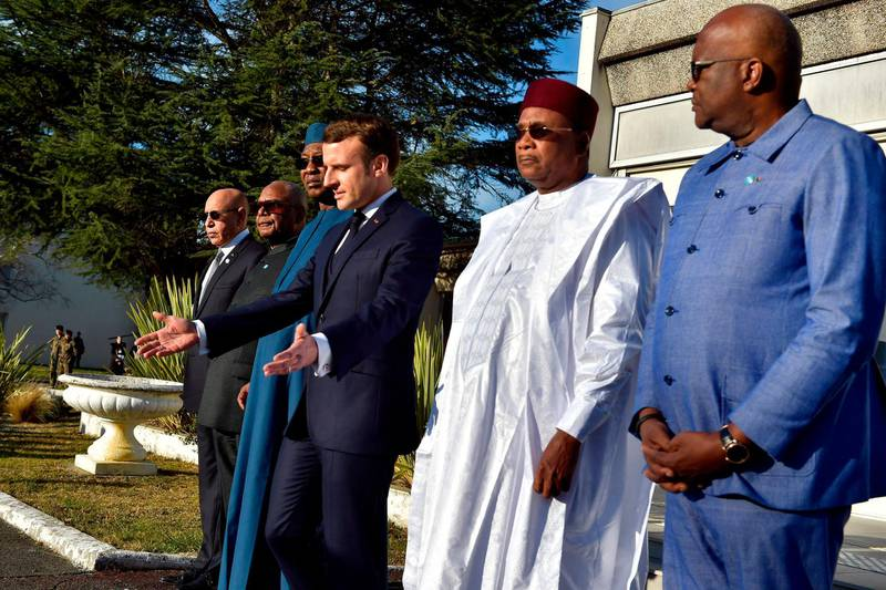 (From L) Mauritanian President Mohamed Ould Ghazouani, Malian President Ibrahim Boubacar Keita, Chadian President Idriss Deby, French President Emmanuel Macron, Nigerien President Mahamadou Issoufou and Burkinabe President Roch Marc Christian Kabore attend a ceremony in Pau, south-western France, on January 13, 2020, in memory of the seven soldiers of the 5eme regiment d'helicopteres de combat (RHC) who were killed in Mali in November 2019, and ahead of a meeting with Heads of State who are gathering to discuss the continuing anti-jihadist fight in the African region of Sahel.   / AFP / POOL / Alvaro BARRIENTOS