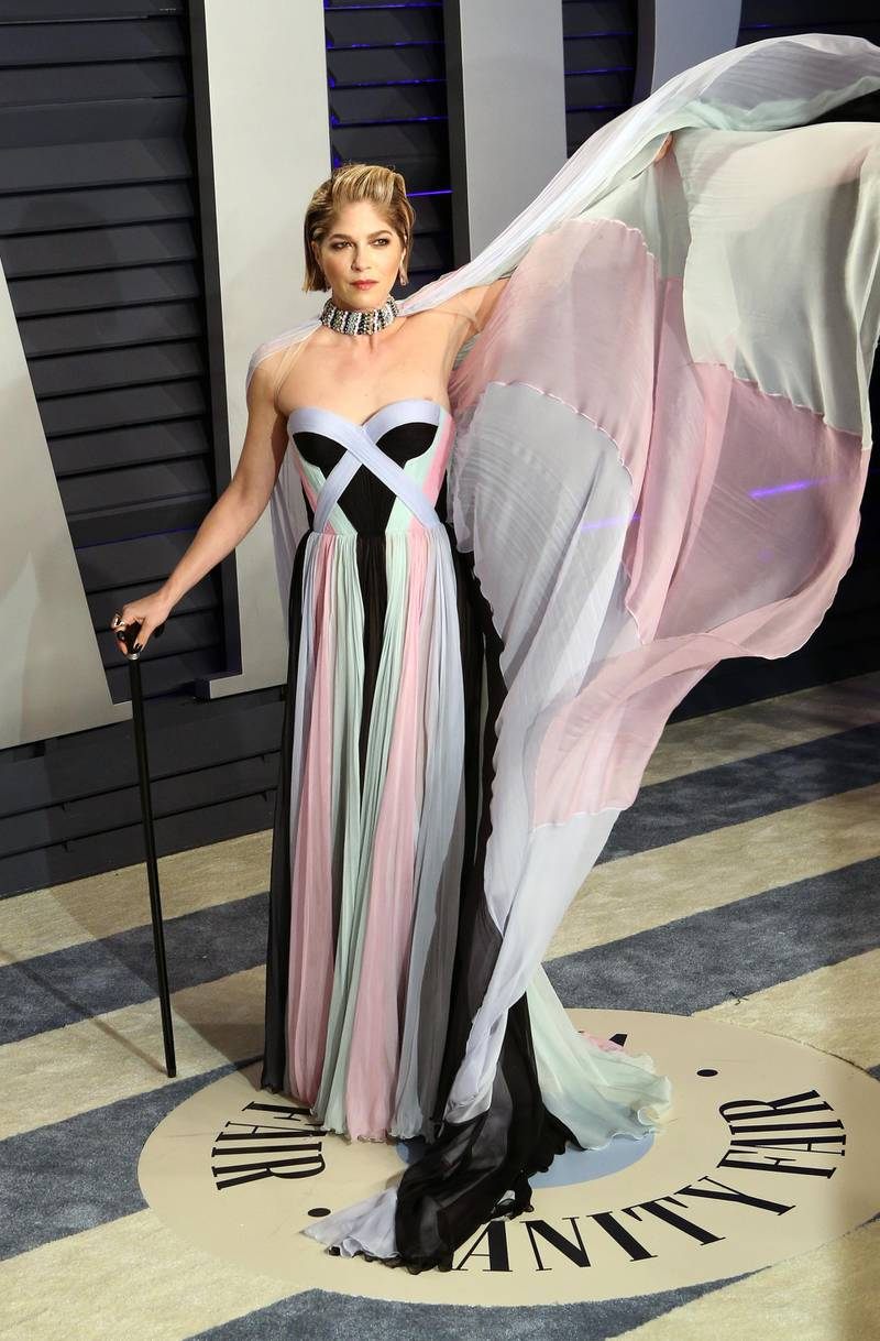 epa07396035 American actress Selma Blair poses at the 2019 Vanity Fair Oscar Party following the 91th annual Academy Awards ceremony, in Beverly Hills, California, USA, 24 February 2019. Pastel dress and cape by Ralph & Russo Couture. The Oscars are presented for outstanding individual or collective efforts in 24 categories in filmmaking.  EPA-EFE/NINA PROMMER