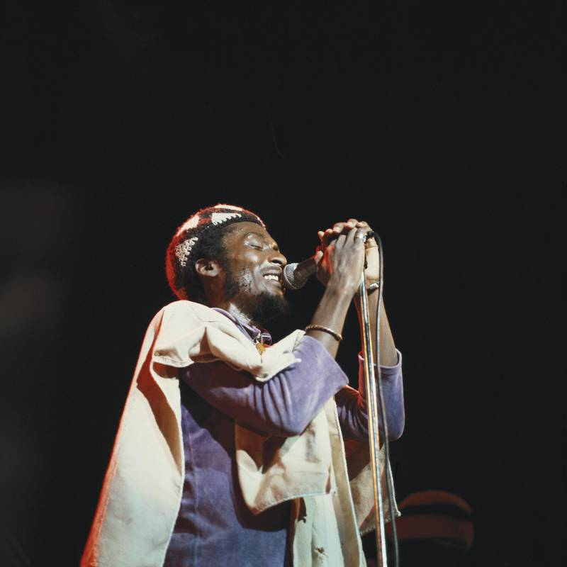 Jimmy Cliff, Jamaican ska and reggae singer, singing into a microphone during a live concert performance on stage at the Hammersmith Odeon in London, England, Great Britain, in November 1978. (Photo by David Redfern/Redferns/Getty Images)