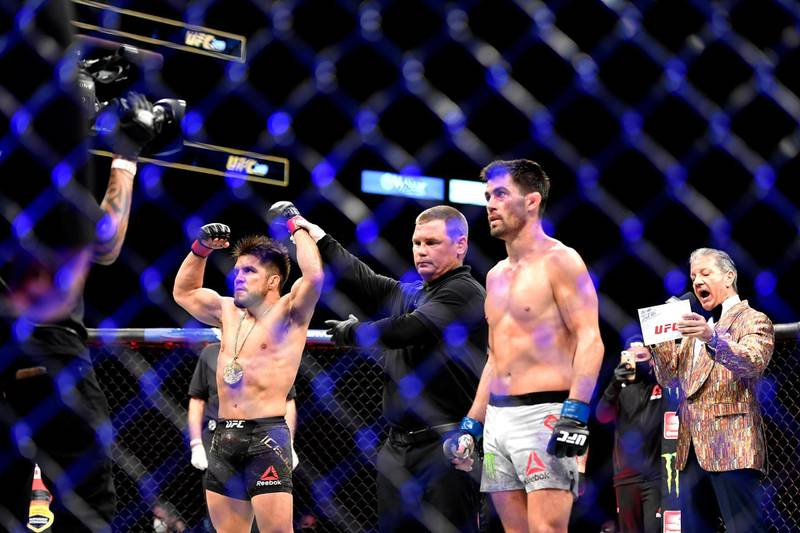 JACKSONVILLE, FLORIDA - MAY 09: Henry Cejudo (L) of the United States celebrates defeating Dominick Cruz (R) of the United States in their bantamweight title fight during UFC 249 at VyStar Veterans Memorial Arena on May 09, 2020 in Jacksonville, Florida.   Douglas P. DeFelice/Getty Images/AFP