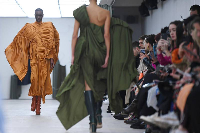 Models present creations by designer Richard Malone during a presentation for their Autumn/Winter 2020 collection on the first day of London Fashion Week in London on February 14, 2020. (Photo by DANIEL LEAL-OLIVAS / AFP)