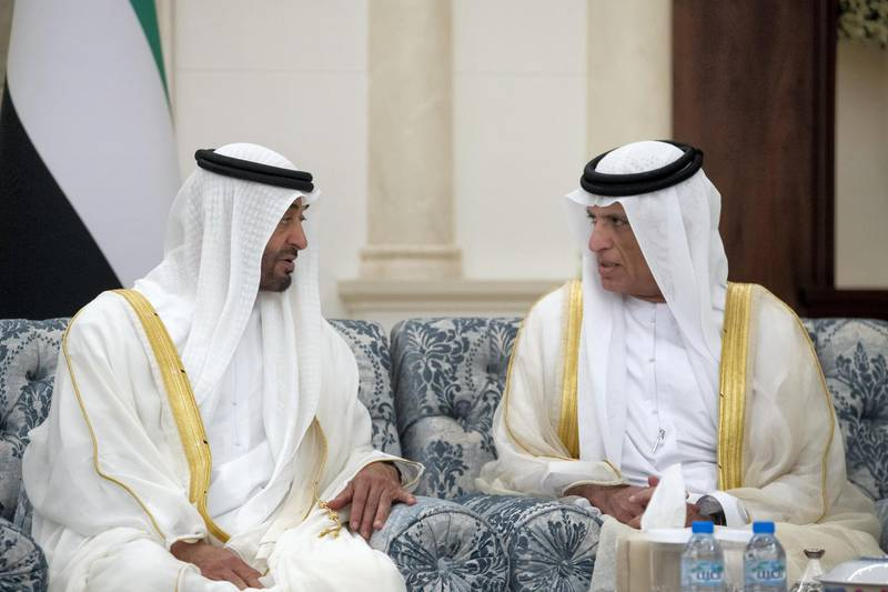 ABU DHABI, UNITED ARAB EMIRATES - August 11, 2019: HH Sheikh Mohamed bin Zayed Al Nahyan, Crown Prince of Abu Dhabi and Deputy Supreme Commander of the UAE Armed Forces (L), speaks with HH Sheikh Saud bin Saqr Al Qasimi, UAE Supreme Council Member and Ruler of Ras Al Khaimah (R), during an Eid Al Adha reception at Mushrif Palace.  ( Ryan Carter for the Ministry of Presidential Affairs ) ---