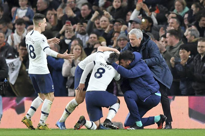 Tottenham Hotspur's South Korean striker Son Heung-Min celebrates with teammates and Tottenham Hotspur's Portuguese head coach Jose Mourinho (R) after scoring their second goal during the English Premier League football match between Tottenham Hotspur and Manchester City at Tottenham Hotspur Stadium in London, on February 2, 2020. (Photo by Ben STANSALL / AFP) / RESTRICTED TO EDITORIAL USE. No use with unauthorized audio, video, data, fixture lists, club/league logos or 'live' services. Online in-match use limited to 120 images. An additional 40 images may be used in extra time. No video emulation. Social media in-match use limited to 120 images. An additional 40 images may be used in extra time. No use in betting publications, games or single club/league/player publications. /