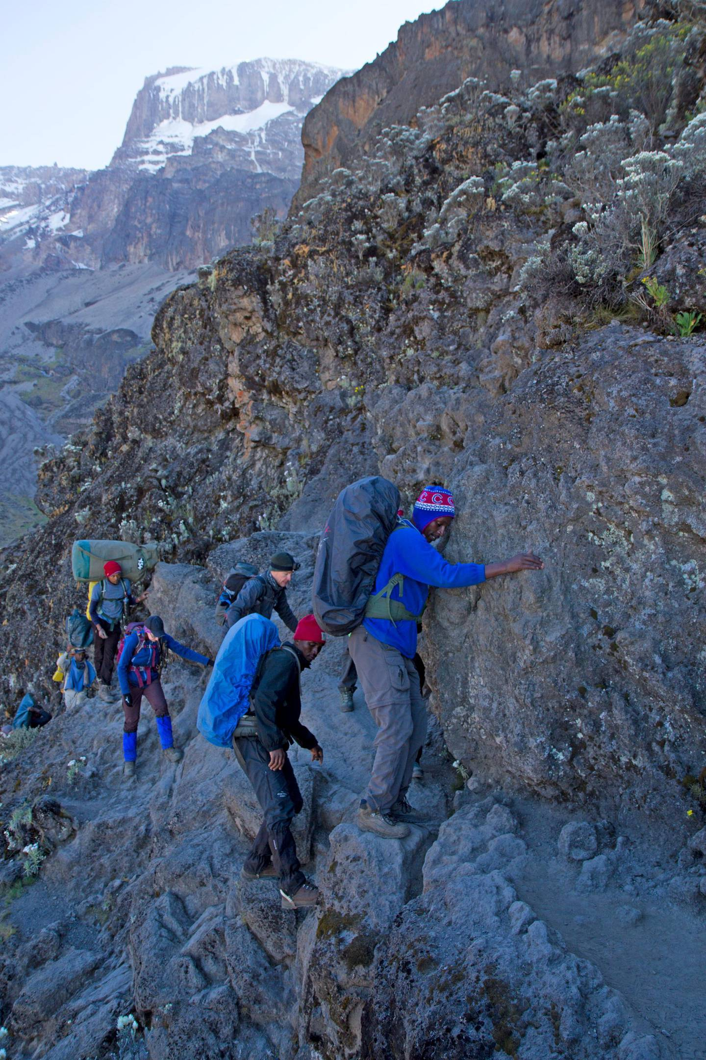 Mt Kilimanjaro National Park, Tanzania, July 1 2017: A group of trekkers inches around the so-called Kissing Rock on the tricky Barranco Wall section of trail on Mt Kilimanjaro. Getty Images