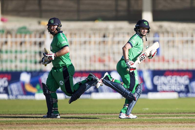 Ireland's bastmen William Porterfield (R) Paul Stirling run between the wickets during 2nd one day international (ODI) cricket match between Afghanistan and Ireland at Sharjah Cricket Association Stadium in Sharjah on December 7, 2017. / AFP PHOTO / NEZAR BALOUT