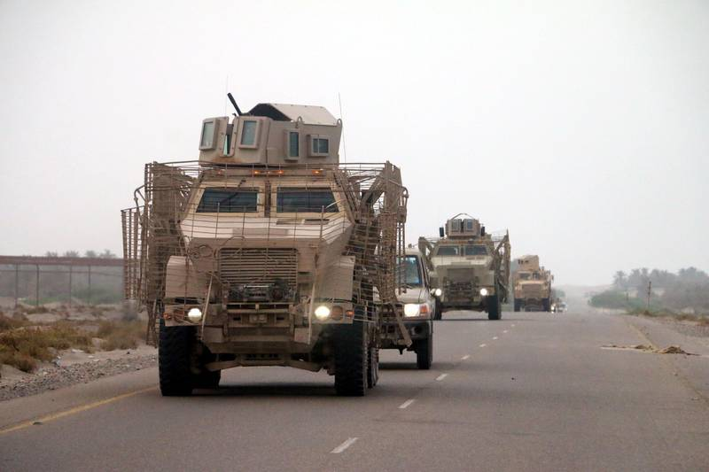 epa06803032 Yemeni forces backed by the Saudi-led coalition gather near the outskirts of the western port city of Hodeidah, Yemen, 12 June 2018. According to reports, the Saudi-led military coalition and Yemeni government forces continue to send reinforcements toward the port city of Hodeidah, preparing to launch an assault on the Houthis-controlled main port of Yemen.  EPA/NAJEEB ALMAHBOOBI