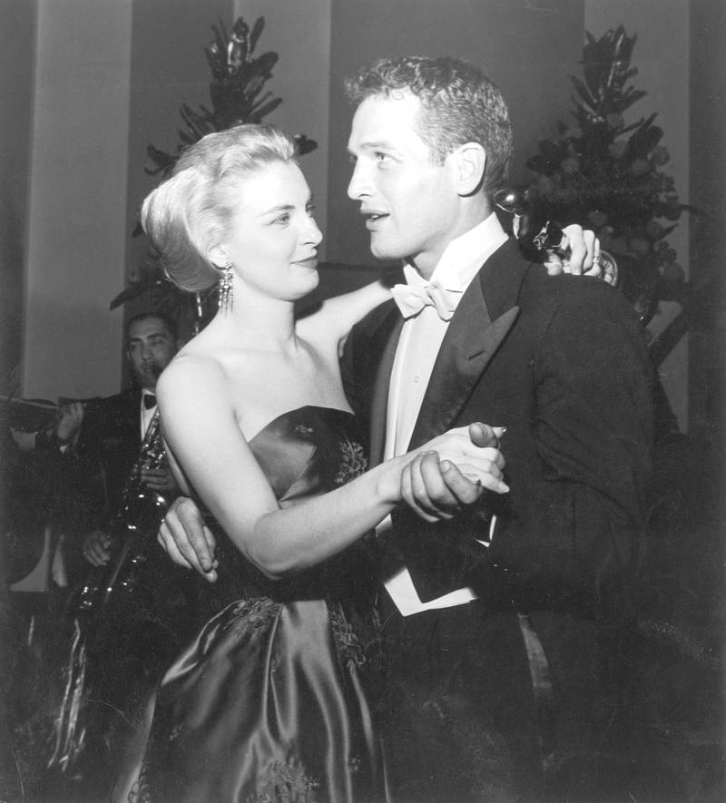 Married American actors Paul Newman and Joanne Woodward share a dance as Woodward holds her Best Actress Oscar statuette, during the Academy Awards party at the Beverly Hilton, Beverly Hills, California, March 26, 1958 . Woodward won the award for her starring role in the film, 'The Three Faces Of Eve,' directed by Nunnally Johnson. (Photo by Darlene Hammond/Getty Images)