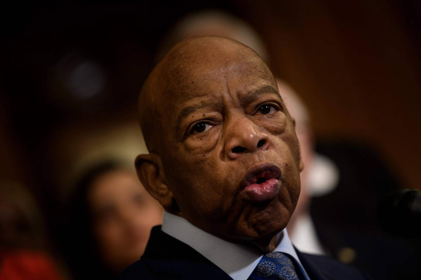 """(FILES) In this file photo taken on December 6, 2019 Rep. John Lewis (D-GA) speaks during a press conference about voting rights on Capitol Hill in Washington, DC. US President Donald Trump said he doesn't know how history will remember civil rights activist John Lewis, but that """"he chose not to come to my inauguration,"""" in an interview with US media. A longtime Democratic congressman, Lewis died on July 17, then received rare honors in Washington and was praised by key figures of both major parties for his life-long fight for equality. """"How do you think history will remember John Lewis?"""" Jonathan Swan of the Axios media outlet asked Trump in the interview aired on August 3, 2020.""""I don't know, I really don't know,"""" the president answered.""""I don't know John Lewis, he chose not to come to my inauguration.""""  / AFP / Brendan Smialowski"""