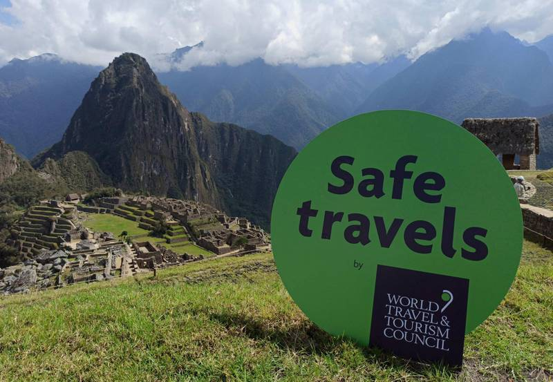 epa08742279 A handout photo made available by the Ministry of Foreign Trade and Tourism of Peru that shows the 'Safe travels' seal in Machu Picchu, Cuzco, Peru, 13 October 2020. Peru received from the World Travel and Tourism Council (WTTC) the Seal 'Safe travels', the first seal of biosecurity and hygiene in the world for tourism in times of COVID-19. Machu Picchu will be part of a second phase of reopening to tourism of archaeological sites that will begin 15 October.  EPA/Ministry of Foreign Trade and Tourism HANDOUT  HANDOUT EDITORIAL USE ONLY/NO SALES