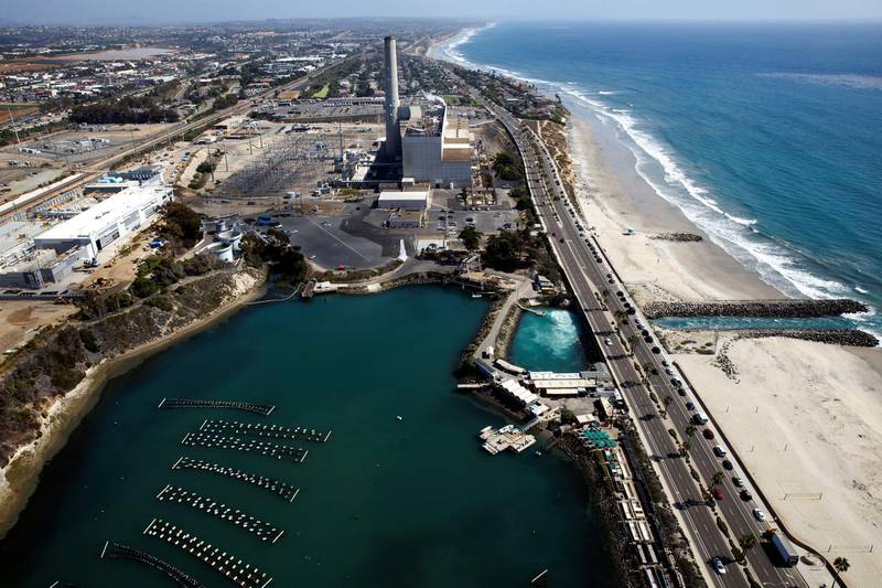 The Carlsbad Desalination plant stands under construction in this aerial photograph taken over Carlsbad, California, U.S., on Monday, Aug. 31, 2015. The $1 billion Carlsbad plant, which uses reverse osmosis to purify seawater, will have the capacity to produce 54 million gallons a day of drinkable water. Photographer: Patrick T. Fallon/Bloomberg via Getty Images