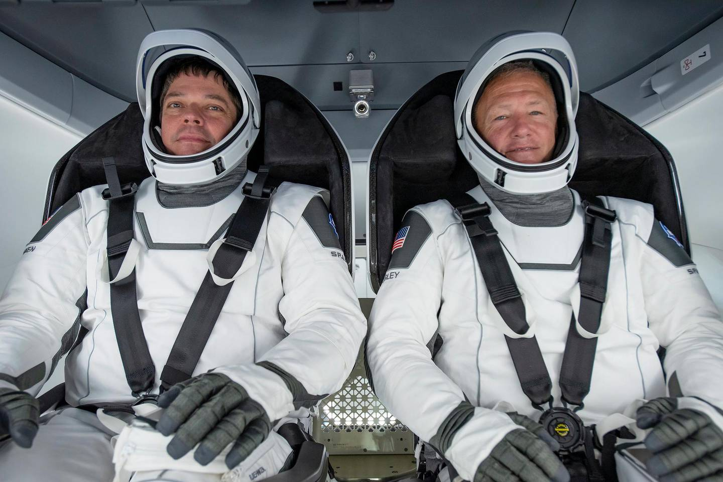 epa08446412 (FILE) - A handout photo made available by SpaceX shows NASA astronauts Bob Behnken (L) and Doug Hurley participating in a test at a SpaceX processing facility on Cape Canaveral Air Force Station in Florida, USA, 30 March 2020 (reissued 27 May 2020). NASA astronauts Robert Behnken and Douglas Hurley are scheduled to ride the Crew Dragon spacecraft to the International Space Station at 4:33 p.m. EDT on 27 May. The launch would be the first manned space flight from US soil since 2011.  EPA/SPACEX HANDOUT  HANDOUT EDITORIAL USE ONLY/NO SALES