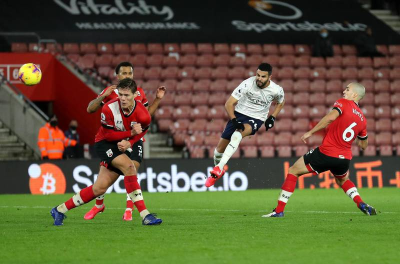 SOUTHAMPTON, ENGLAND - DECEMBER 19: Riyad Mahrez of Manchester City takes a shot during the Premier League match between Southampton and Manchester City at St Mary's Stadium on December 19, 2020 in Southampton, England. A limited number of fans (2000) are welcomed back to stadiums to watch elite football across England. This was following easing of restrictions on spectators in tiers one and two areas only. (Photo by Naomi Baker/Getty Images)