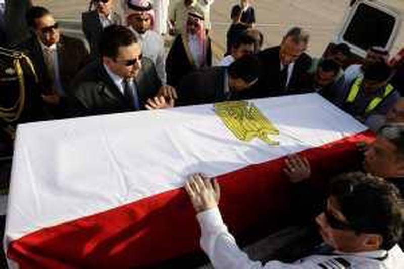 Officials carry the coffin of Sheikh Mohamed Sayed Tantawi, the head of Egypt's most prestigious seat of Islamic learning al Azhar, at King Khalid International Airport in Riyadh March 10, 2010. Tantawi died of a heart attack on Wednesday during a visit to Saudi Arabia, religious officials at al-Azhar said. He was 81.    REUTERS/Fahad Shadeed  (SAUDI ARABIA - Tags: POLITICS OBITUARY RELIGION) *** Local Caption ***  AMM07_SAUDI-EGYPT-_0310_11.JPG *** Local Caption ***  AMM07_SAUDI-EGYPT-_0310_11.JPG