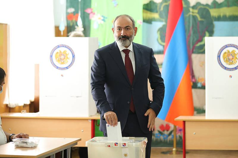 epa09287747 Armenian Prime Minister Nikol Pashinyan casts his ballot at a polling station in Yerevan, Armenia, 20 June 2021. Armenians headed to the polls for early parliamentary election in which candidates Prime Minister Nikol Pashinyan and former President Robert Kocharyan are considered the favorites. The early parliamentary election caused by a political crisis in the country after defeat in the Nagorno-Karabakh conflict with Azerbaijan.  EPA/ARMENIAN PRIME MINISTER PRESS SERVICE / POOL