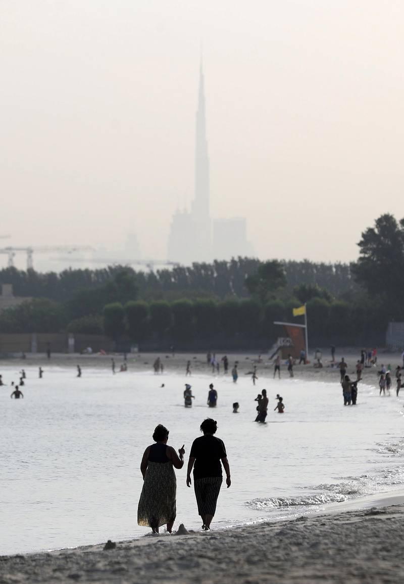 Dubai, United Arab Emirates - Reporter: N/A. News. Weather. Two ladies walk on the beach in Dubai as the sunrises. Tuesday, June 16th, 2020. Dubai. Chris Whiteoak / The National