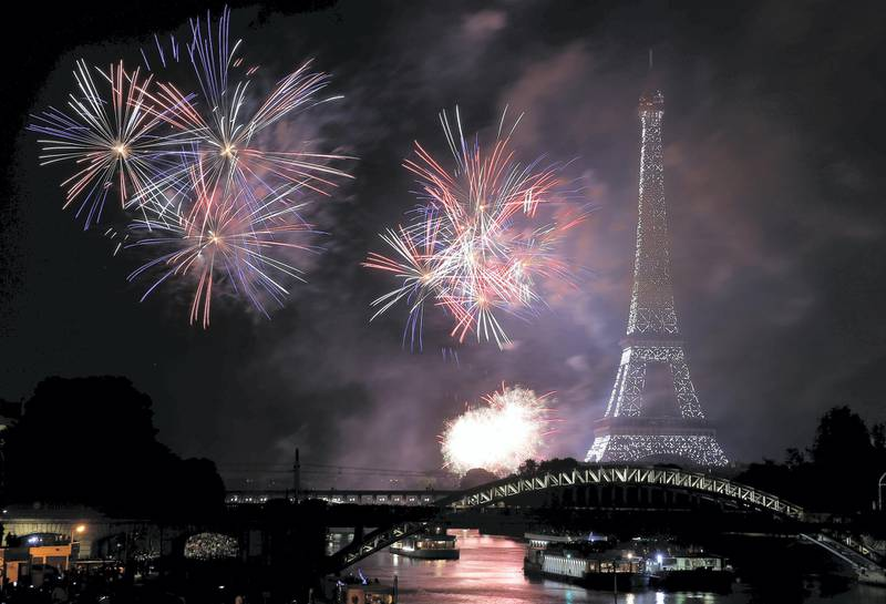 """PARIS, FRANCE - JULY 14: Fireworks burst around the Eiffel Tower as part of Bastille Day celebrations on July 14, 2019 in Paris, France. This year, the theme is the """"Fete de la Federation"""", celebrated in 1790, a year after the storming of the Bastille. (Photo by Thierry Chesnot/Getty Images)"""
