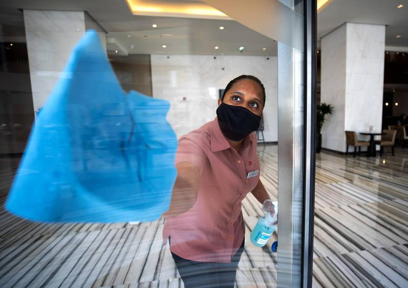 Abu Dhabi, United Arab Emirates, July 8, 2020.    A cleaner sanitises the lobby of Marriot Hotel Downtown, Abu Dhabi.Victor Besa  / The NationalFor:  Hotels Opening AUHSection:  NA Reporter: