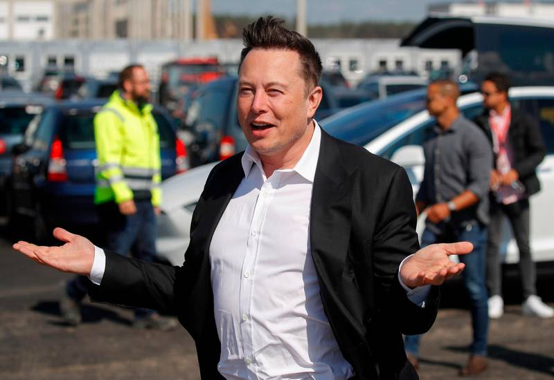 (FILES) This file photo taken on September 3, 2020 shows Tesla CEO Elon Musk gesturing as he arrives to visit the construction site of the future US electric car giant Tesla, in Gruenheide near Berlin. The boom in demand for placing small satellites into orbit has boosted interest in small rockets, but industry players do not think the niche will become a business segment of its own. / AFP / Odd ANDERSEN