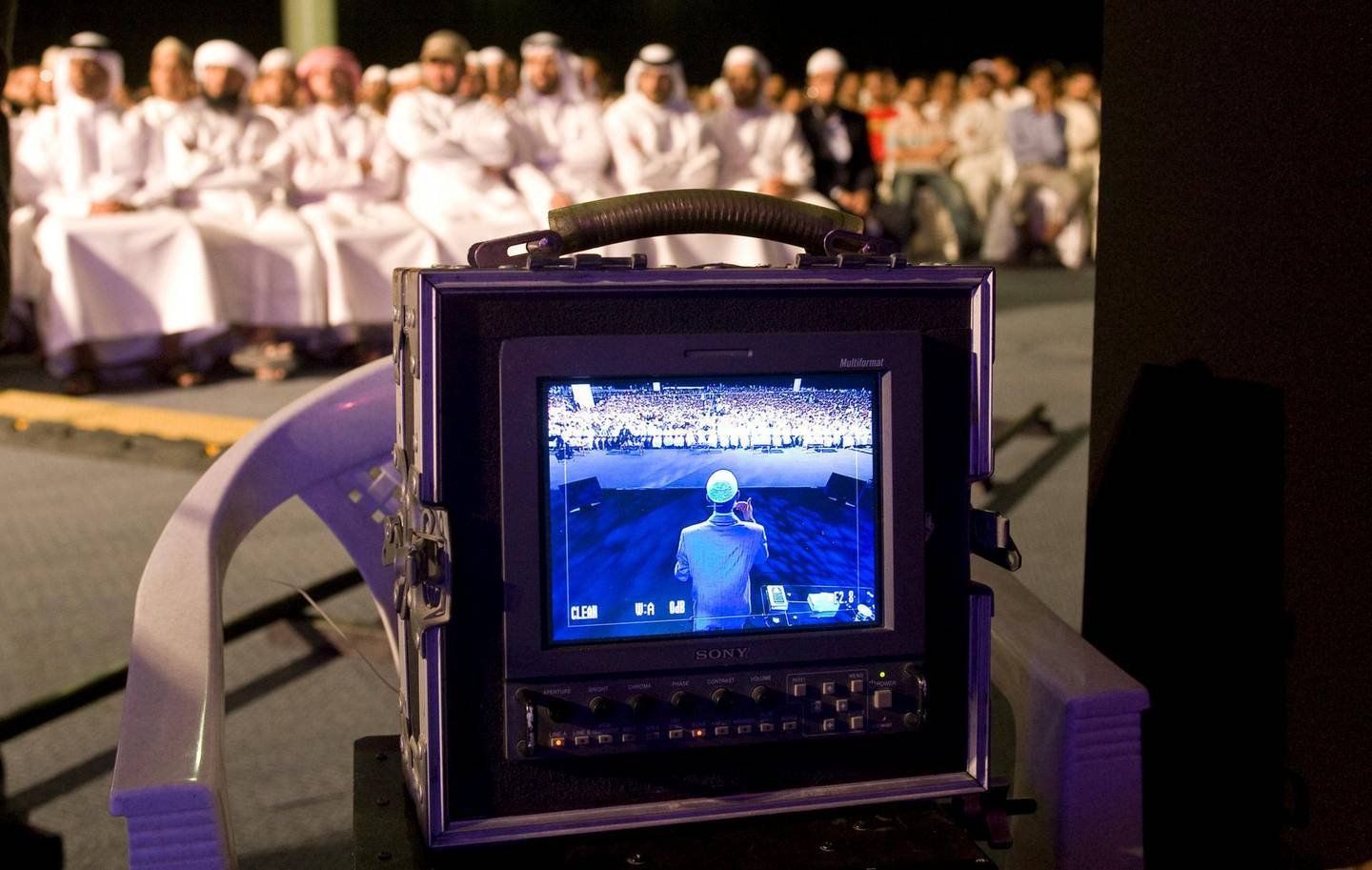 Dubai - August 27, 2009 - Dr. Zakir Naik can be seen on the TV monitor as he speaks before 15,000 people at the Dubai Airport Expo Center in Dubai August 27, 2009.  (Photo by Jeff Topping/The National)  *** Local Caption ***  JT008-0827-DR. ZAKIR NAIK_MG_0707.jpg