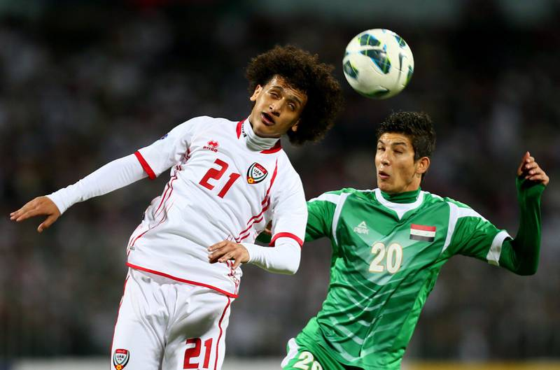 Dhurgham Ismael (R) of Iraq vies with Omar Abdelrahman of UAE as he attempts to score during the 21st Gulf Cup's final between United Arab Emirates (UAE) and Iraq on January 18, 2013 in Manama. United Arab Emirates won 2-1 against  Iraq.  AFP PHOTO/MARWAN NAAMANI  *** Local Caption ***  291255-01-08.jpg