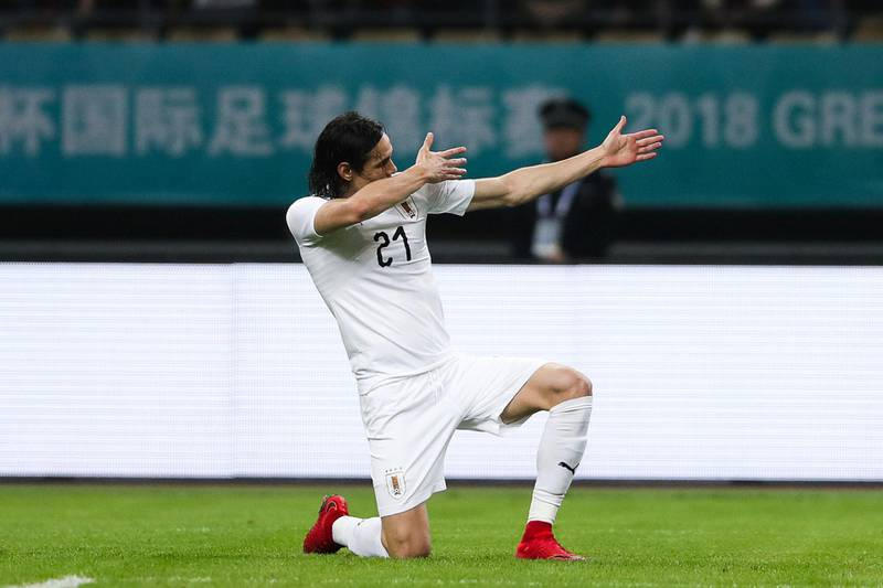 Football Soccer - Wales v Uruguay - China Cup Finals - Guangxi Sports Center, Nanning, China - March 26, 2018. Edinson Cavani of Uruguay celebrates scoring a goal. REUTERS/Stringer ATTENTION EDITORS - THIS IMAGE WAS PROVIDED BY A THIRD PARTY. CHINAOUT. NO COMMERCIAL OR EDITORIAL SALES INCHINA.
